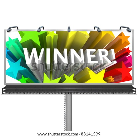 An outdoor billboard announces to the word that the winner has been chosen and congratulates the lucky victor in the competition for the prize or successful candidate - stock photo