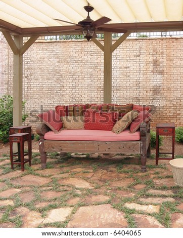 An outdoor living space with warm light tones. - stock photo