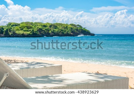 An outdoor lounger/daybed in the shade on a beautiful tropical beach in Bali, Indonesia. - stock photo