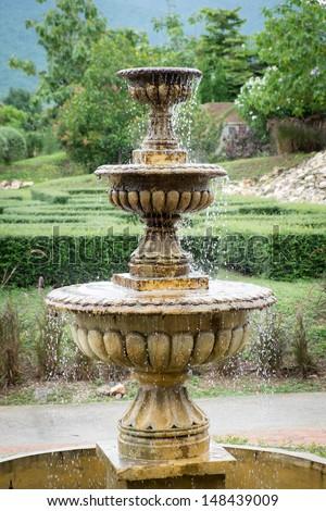An outdoor park water fountain - stock photo