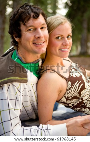 An outdoor portrait of a happy couple on a camping trip - stock photo
