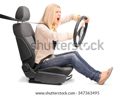 An outraged young woman pretending to drive and honking the horn isolated on white background - stock photo