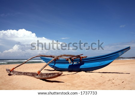 An outrigger by the shore at Bentota Beach, Sri Lanka