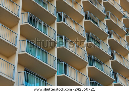 An Outside view of balconies of a hotel or apartment complex - stock photo