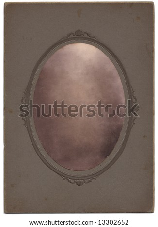 An oval vintage photograph. Clipping paths included. The portrait has been removed, leaving the texture to allow the easy insertion of any picture using blendng modes. - stock photo