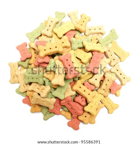An overhead shot of a pile of bone shaped dog treats isolated on white. - stock photo