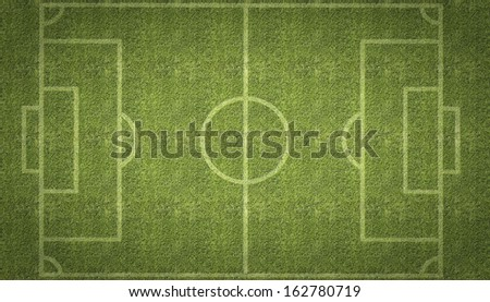 An overhead view of a football soccer pitch with white markings painted on grass. - stock photo