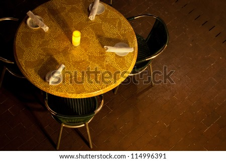 An overhead view of a table set for dinner at an outdoor cafe. - stock ...