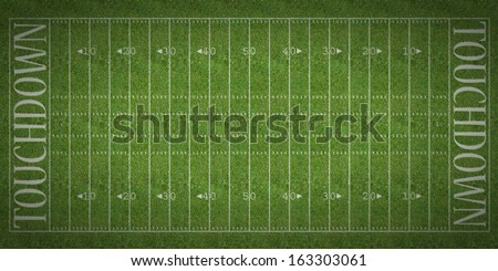 An overhead view of an american football field with white markings painted on grass. - stock photo