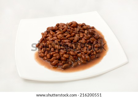 An overhead view of canned black beans - stock photo