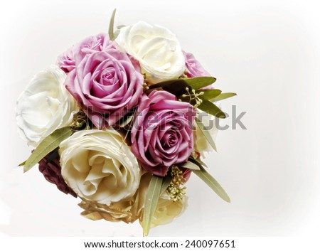 An overhead view of purple and white rose bouquet.