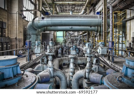 An overview of a sub level pipeline construction at an old abandoned factory, a maze of tube-lines creating a wonderful composition. - stock photo