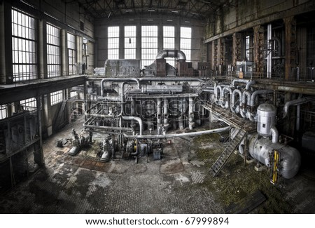 An overview of the main generator hall at an abandoned energy plant - stock photo