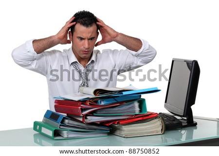 An overwhelmed businessman. - stock photo