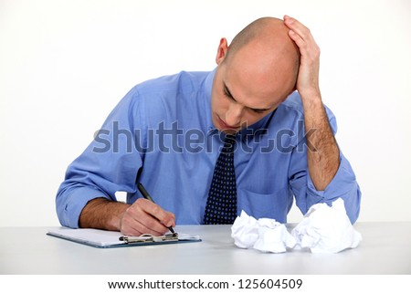 An overwhelmed executive. - stock photo