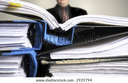 An overworked  business man - stock photo