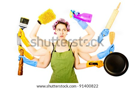 An overworked very busy multitasking housewife under stress - stock photo