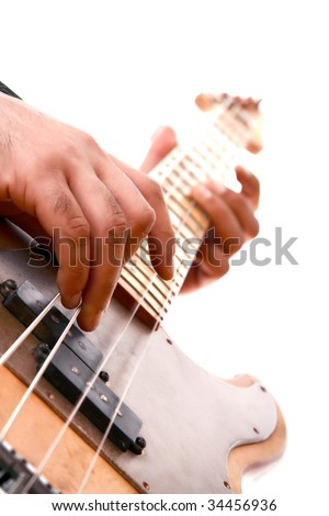 an playing electrical bass - stock photo