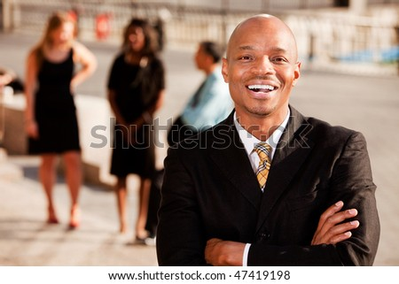 An portrait of an African American Business Man in an outdoor setting