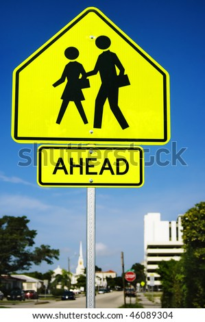 an school crosswalk ahead traffic sign in a road - stock photo