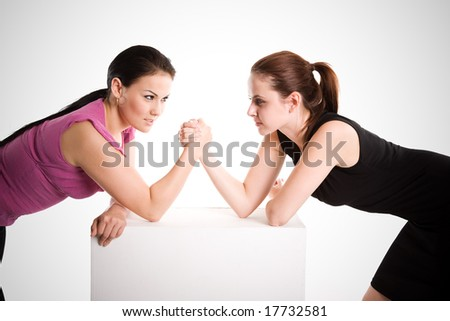 An shot of two businesswomen arm wrestling - stock photo