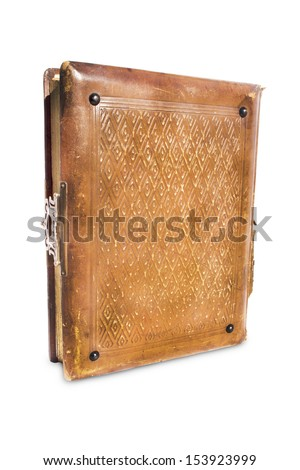 An slightly open old leather bound antique book with a brass lock and hasp on an isolated background - stock photo