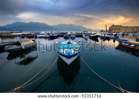 An small Italian harbour with boats in the spring morning light - stock photo