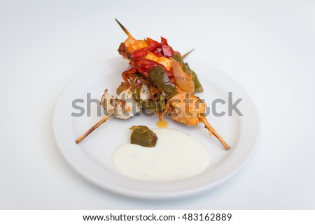 "An spanish ""tapa"" of grilled chicken with peppers."