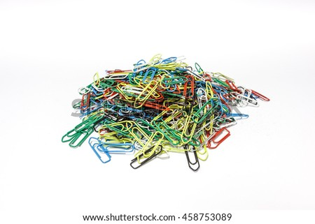 an stack of colored paper clips on a white surface