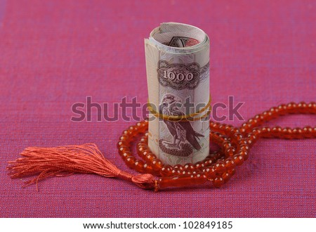An UAE Dirhams and islamic rosary - stock photo