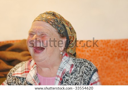 An ugly woman with red interesting face - stock photo