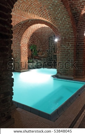 an underground swimming-pool in a castle - stock photo
