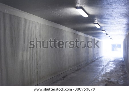An underground tunnel high angle with light - stock photo