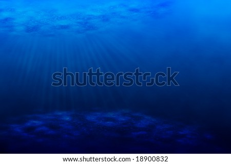 An underwater scene with sun rays shining through the water's glittering and moving surface. - stock photo