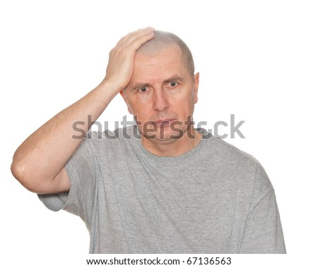 An unexpectedly unpleasantly surprised male isolated on white. - stock photo