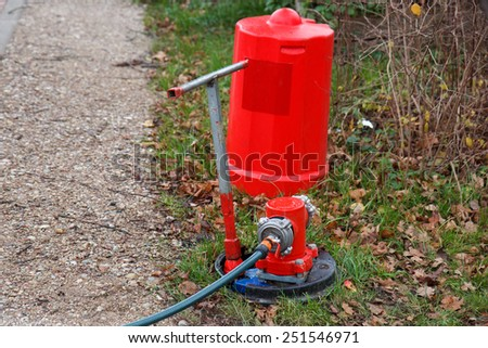 An unfinished fire hydrant in the process of setting up - stock photo