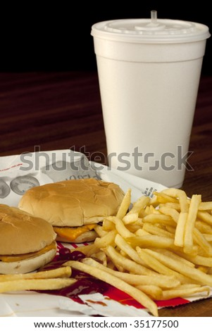 An unhealthy fast food dinner for two - stock photo