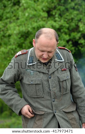 An unidentified person wears historical german uniform . At May 7,2016 in Kiev, Ukraine
