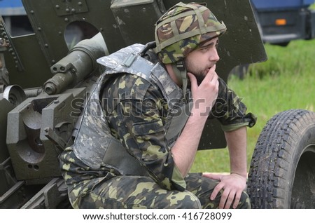 An unidentified person wears modern Ukrainian nazionalist battalion uniform . At May 7,2016 in Kiev, Ukraine