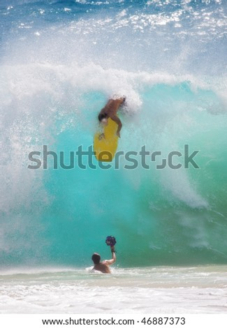 An unidentified young man participating in Big Wave Surfing using mini-board, Sunset Beach, Oahu, Hawaii, on February 15, 2009. - stock photo
