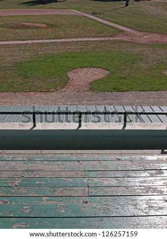 An unoccupied baseball field, shot from the bleachers. - stock photo