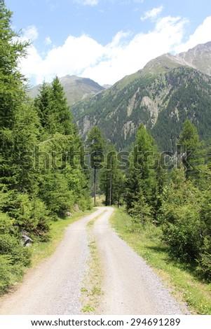 An unpaved road on Alp Mountains in Soelden, Tirol, Austria. - stock photo