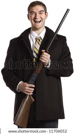 An unstable businessman clutching a shotgun. - stock photo
