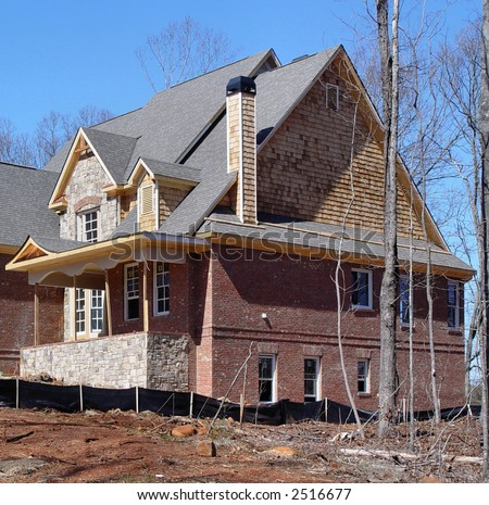 An upper-middle income suburban home in Atlanta under construction. - stock photo