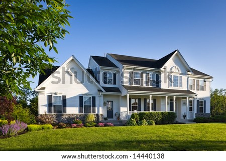 An upscale and appealing modern single family house in a surburban setting in the spring. - stock photo