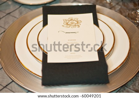 an upscale dinning set with a menu on top - stock photo