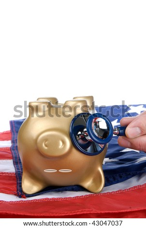 An upside down, nearly dead piggy bank on an American flag is being examined for signs of economic and financial life.  Image can be good for health care, economic or financial inferences. - stock photo