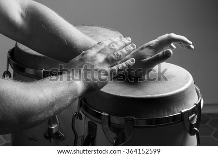 An vintage Bongo Drum that is played by a drummer.