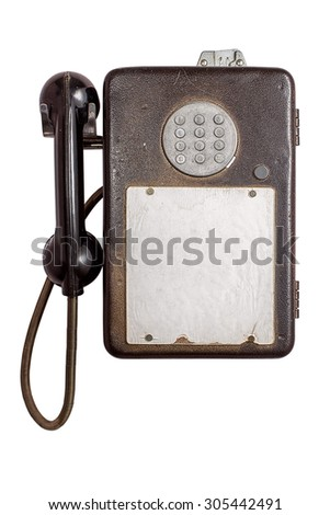An vintage pay phone isolated on white background with free text space - stock photo