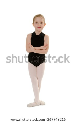 An 8 year old Child Ballet Student in Dance Class Uniform - stock photo